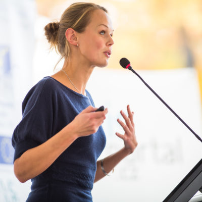 woman speaking at a conference